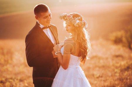 Beautiful newlyweds in mountains