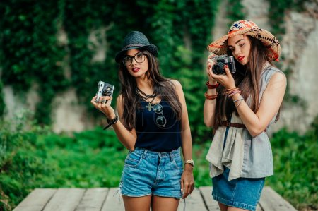 girls with cameras in park