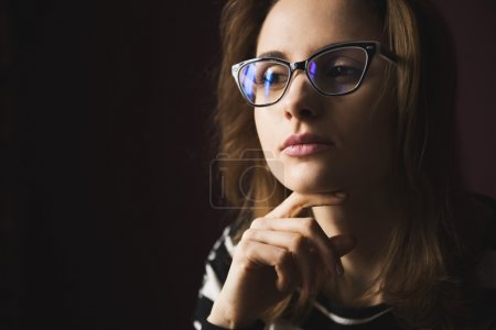 Young girl in fashion glasses