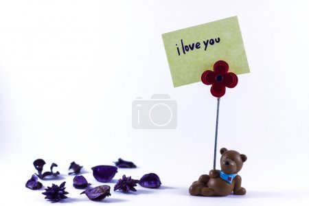 Photo for Teddy bear with a I Love You sign in a white background - Royalty Free Image