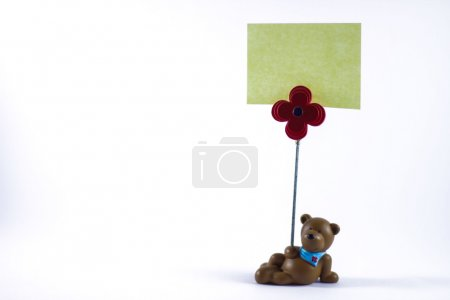 Photo for Teddy bear with a blank sign in a white background - Royalty Free Image
