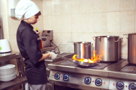 Chef Cooking With Fire In Frying Pan