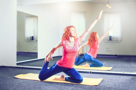 Photo for Fitness, sport, training and people concept - smiling woman doing exercises on mat in gym - Royalty Free Image