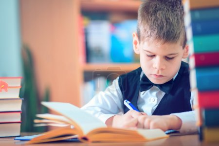 Photo for Kid  Reading Book, Pupil Learn Lesson and Dream, Education - Royalty Free Image