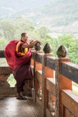 Buddhist monk standing in monastery