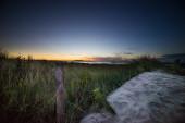 Picketed fence sunrise