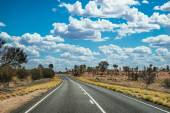 Driving up the road in Australian outback