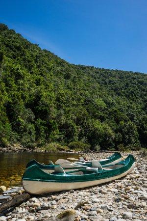 Canoes on river coast