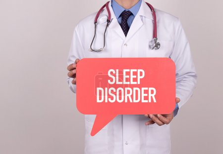 Photo for Doctor holding speech bubble with sleep disorder message - Royalty Free Image