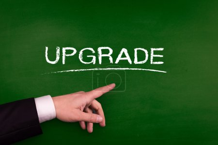 Businessman pointing on upgrade