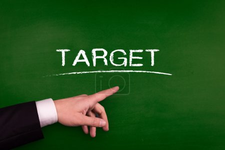Businessman pointing on target