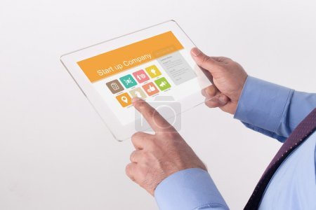 Businessman holding transparent tablet pc