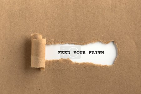 Photo for Torn brown paper with feed your faith text on it - Royalty Free Image