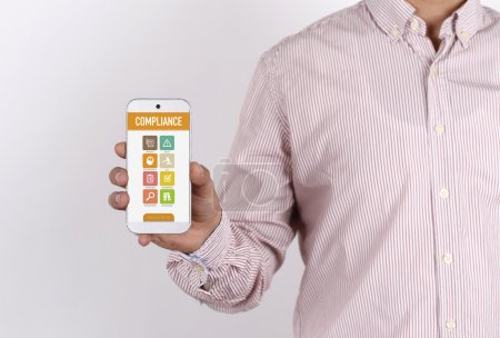 Businessman showing smartphone