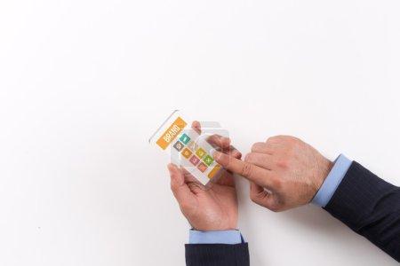 Businessman holding transparent smartphone