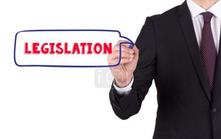 Photo pour Homme d'affaires écriture avec marqueur sur le tableau blanc texte législation - image libre de droit