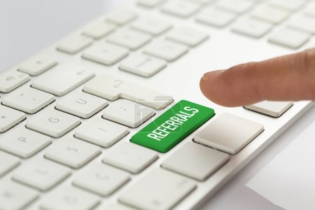 Finger pushing green keyboard button