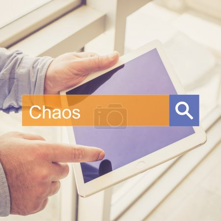 Businessman using tablet searching text chaos...