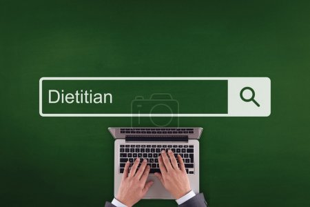 Person typing on laptop keyboard, text DIETITIAN...