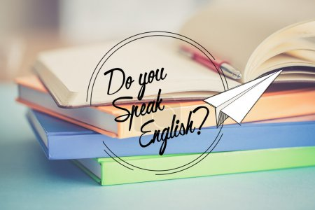 Photo for Do you speak English concept with paper plane and pile of books - Royalty Free Image