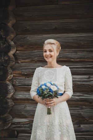 Wedding bouquet in the bride hands