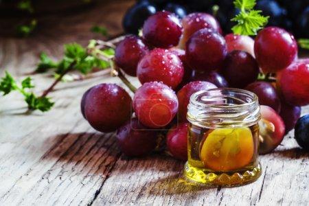 Healing grape seed oil in a glass jar