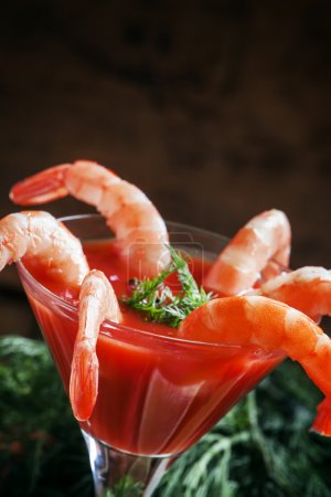 Peeled shrimp with tomato sauce in a martini glass
