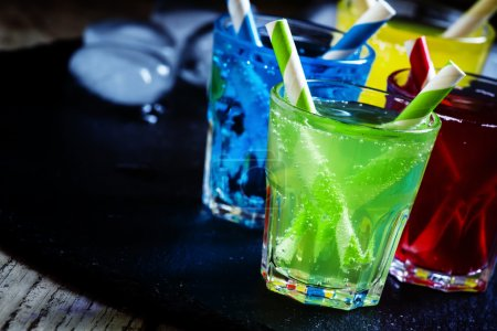 Photo for Colorful cocktails with straws on a dark background, selective focus - Royalty Free Image