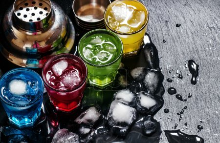 Photo for Cocktails with ice on a dark background, top view - Royalty Free Image
