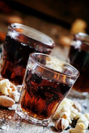 Cola glasses, sweet and savory snacks