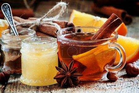 Warming black tea with honey, cinnamon and orange