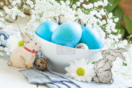 Happy easter! Festive composition with blue easter eggs