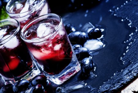 Cold juice of black grapes with ice