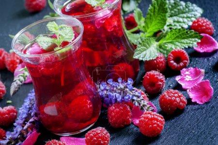 Herbal red tea with raspberries, mint, sage flowers and rose petals