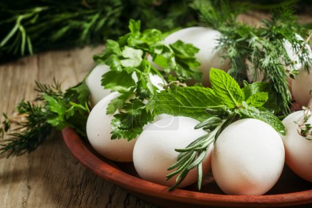 Easter eggs with a pattern of herbs