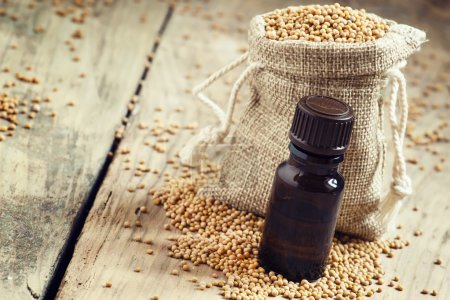 Essential oil of mustard in a small brown glass bottle
