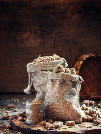 Healthy eating concept: oat bran, oat grain, ground oats