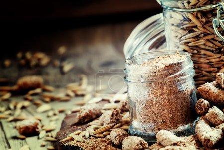 Oat bran, grain oats, oat flour, in glass jars