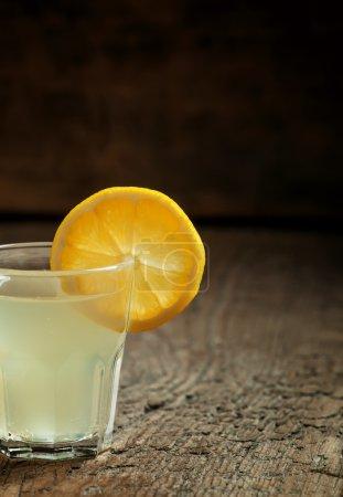 Single glass of vodka with lemon