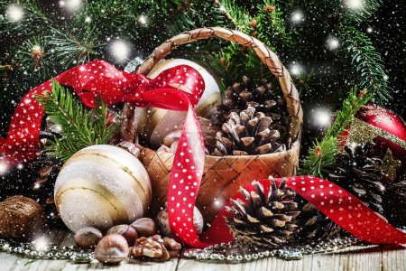 Wicker basket with Christmas balls and pine cones