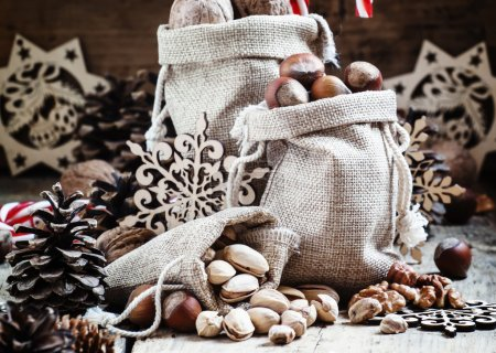 Walnuts, hazelnuts, pistachios in bags made of burlap