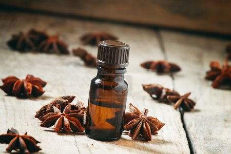 Essential oil of anise in a small brown bottle