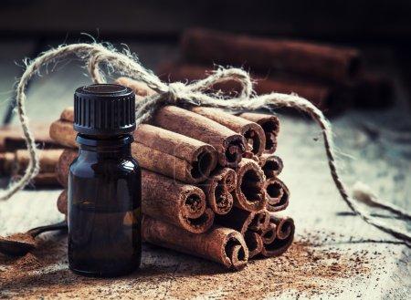 Essential cinnamon oil in a small bottle