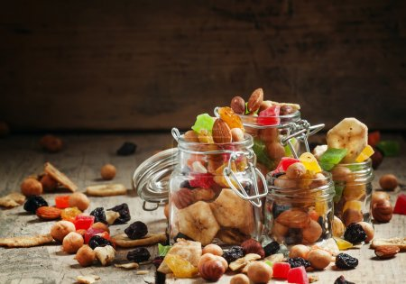 Nuts and dried fruits in glass jars