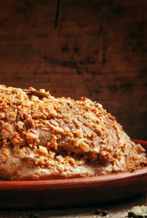 Delicious baked ham pork on a clay tray
