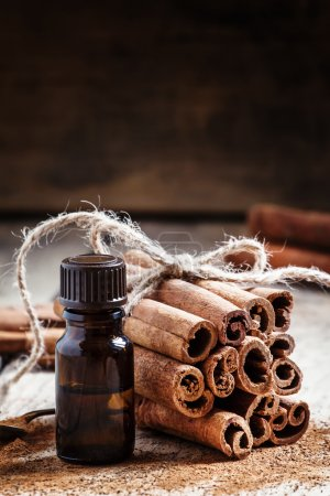 Essential cinnamon oil in a small bottle