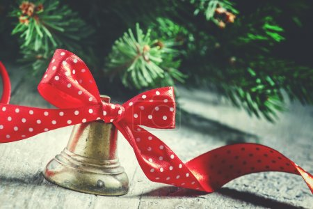 New Year or Christmas bell with a red ribbon in polka dots