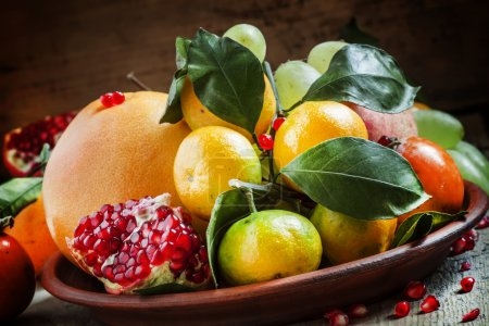 Clay dish with winter fruits