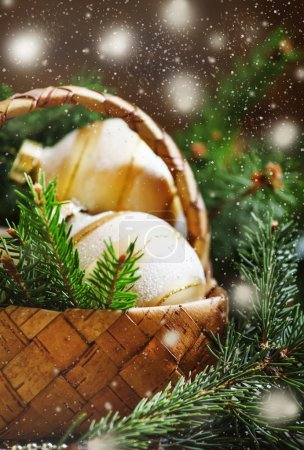 Golden Christmas balls in a wicker basket