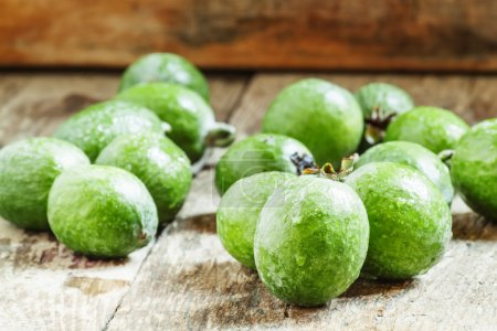 Fresh green feijoa fruits on the old wooden background